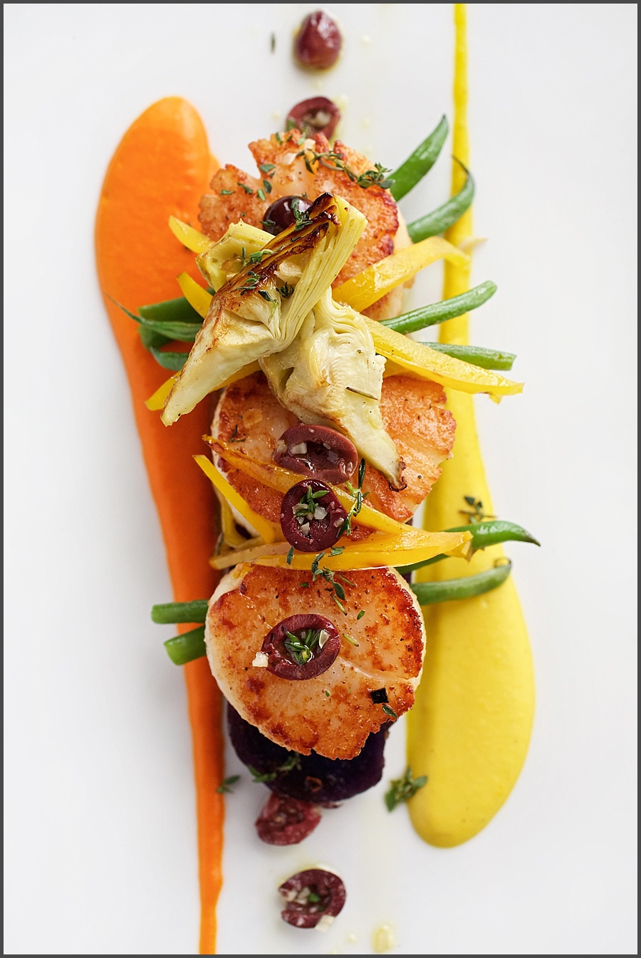 WASHINGTON, DC - Pan Seared Diver Scallops, Roasted Red and Yellow Pepper Coulis with Roasted Artichoke, Haricot Vert and Nicoisse Olives at Marcel